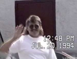 Maurice (Mom) Boucher waves to police officers monitoring the Hells Angels' Sorel bunker in July 1994.