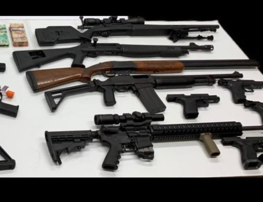 Firearms including two assault-style rifles and a combat shotgun seized during Project Skylark are shown in an OPP handout image.