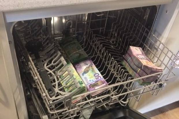 Customs investigators found cash in a dishwasher after seizing 100kg of methamphetamine. Photo / Supplied