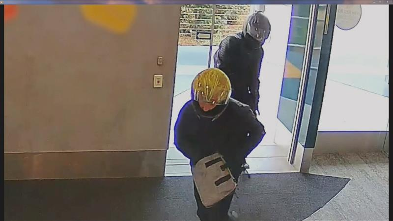 Two armed robbers who stole thousands from a Gold Coast bank were almost stopped by the alleged president of an outlaw motorcycle club before narrowly escaping.