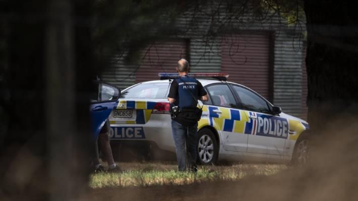 Police outside an address on SH1 near Burnham Army Camp.