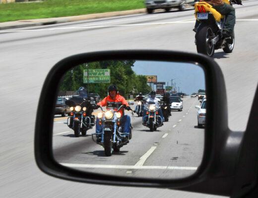 Motorcycles in car mirror