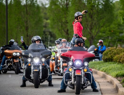 Amber Thompson signals the motorcyclists to rev their engines while she holds her cellphone to show their support to all the health care workers in West Tennessee, in Jackson, Tenn, Tuesday, April 28, 2020. The motorcyclists rode a lap at local hospitals and donated food. (Photo: Stephanie Amador / The Jackson Sun)