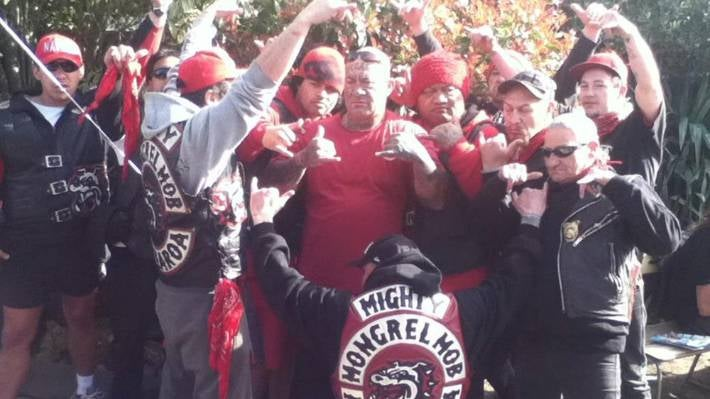 Joseph 'Junior' Wiringi, the president of the Mongrel Mob's Aotearoa chapter, surrounded by members of the gang.