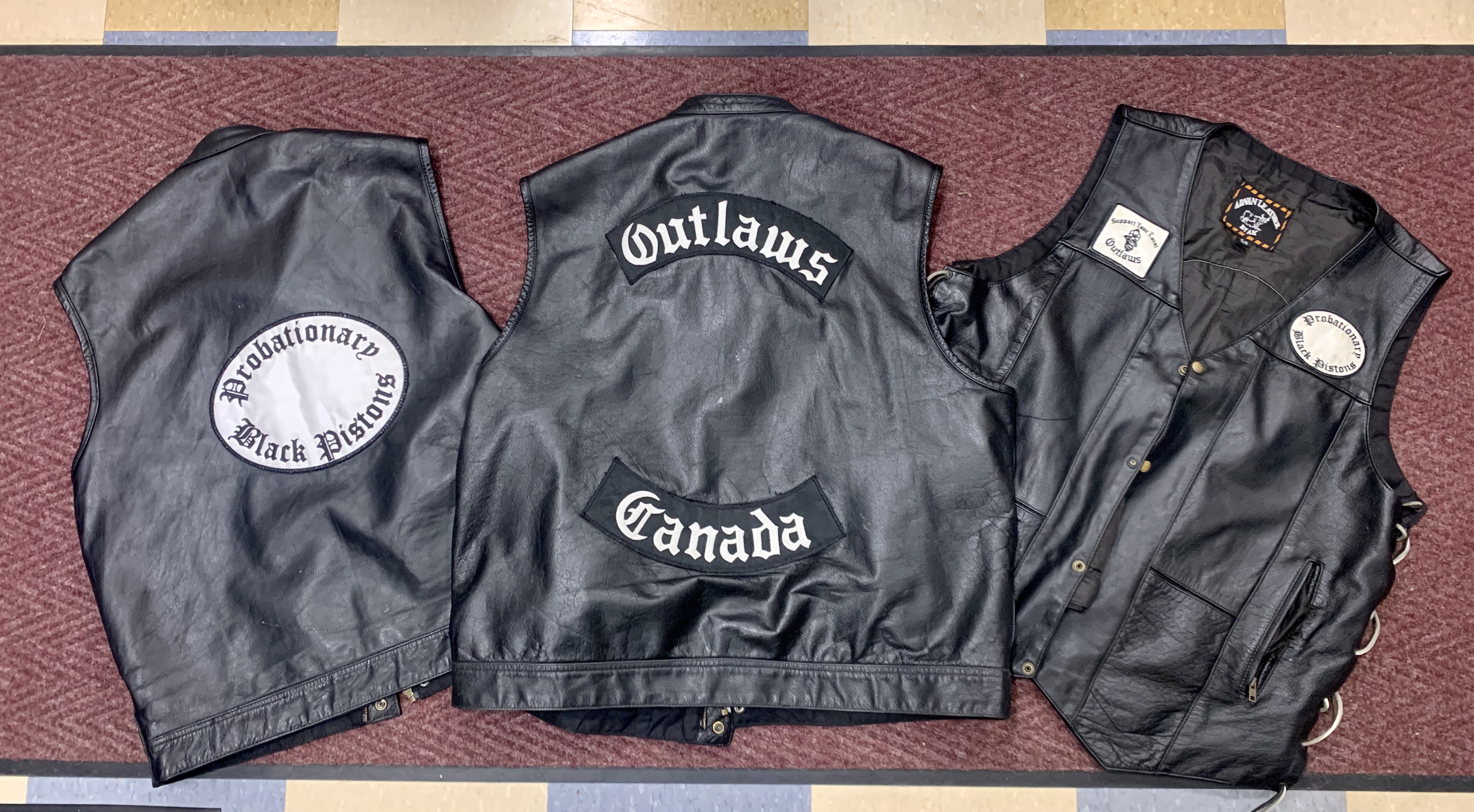 Police seized clothing affiliated with the Black Pistons and Outlaws motorcycle clubs. CONTRIBUTED